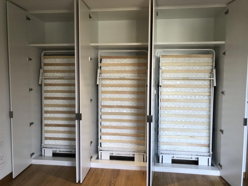 three single wall beds