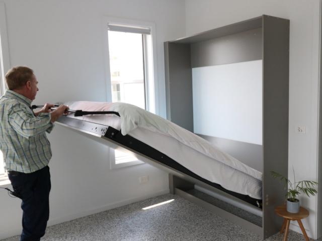 Wall bed being opened